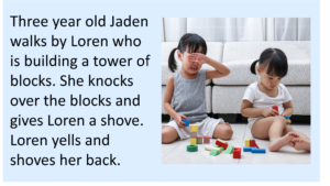 Toddler girls sitting on floor with blocks, one of the girls is crying.